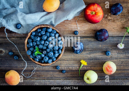 Fruits and berries on wooden background. Colorful fruit flat lay - Stock Photo