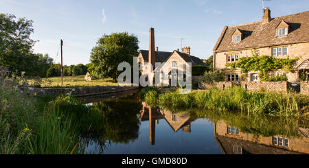 The ancient mill on the river Eye which meanders through the beautiful Cotswold village of Lower Slaughter - Stock Photo