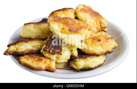 Tasty home cheese pancakes in plate insulated on white background - Stock Photo