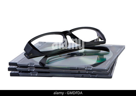 Eyeglasses on stack of CD DVD discs isolated. - Stock Photo