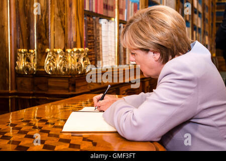 Prague, Czech Republic. 25th Aug, 2016. German Chancellor Angela Merkel signs the book of remembrance during her - Stock Photo