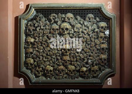 Human skulls and bones in the ossuary in the Church of San Bernardino alle Ossa in Milan, Lombardy, Italy. - Stock Photo