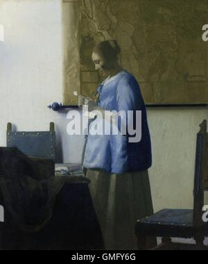 Woman Reading a Letter, by Johannes Vermeer, 1663, Dutch painting, oil on canvas. A young woman in a blue jacket, - Stock Photo
