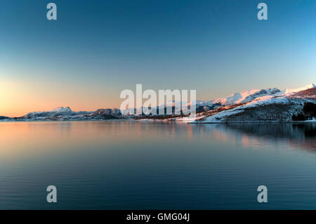 Sunset over the mountains near the Svartisen Glacier Norway - Stock Photo