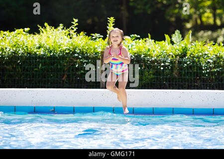 Baby Girl Learning To Swim With Aid Of A Noodle Float Stock Photo Royalty Free Image 25487412