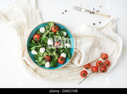 Spring salad with lamb's lettuce, mozzarella and cherry-tomatoes - Stock Photo