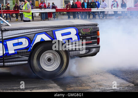 drag racing car wheel spinning to generate heat in tyres to increase grip, york drag raceway track yorkshire united - Stock Photo