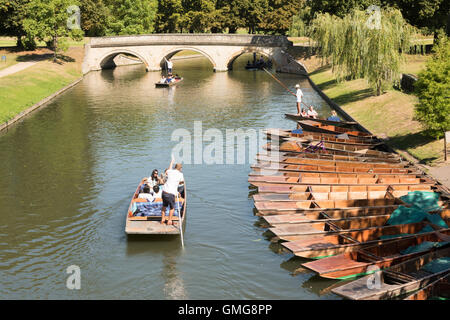 People punting on the River Cam on the Backs at Cambridge Uk in summer - Stock Photo