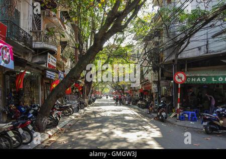 HANOI, Vietnam -  January 1 2015: Downtown street life. Vietnam capital in whinter - Stock Photo