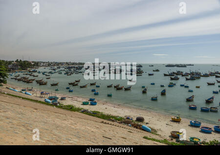 Fishing village and colorful fishing boats near Mui Ne at a sunny day. Vietnam - Stock Photo