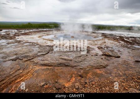 Mineral deposits near the geyser Strokkur, Iceland - Stock Photo