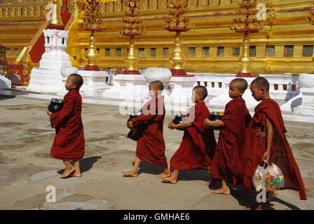 Boy Monks at Shwezigon Pagoda, Bagan, Myanmar - Stock Photo