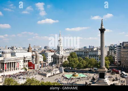 Horizontal aerial view across Trafalgar Square, London on a sunny day. - Stock Photo