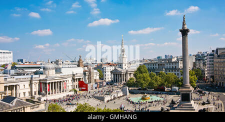 Horizontal panoramic (2 picture stitch) aerial view across Trafalgar Square in London in the sunshine.