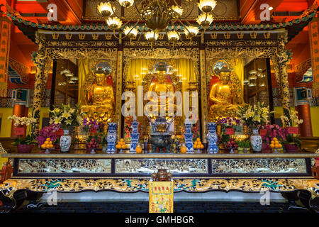 Buddha statues and altar at the Main Shrine Hall of Buddha at the Po Lin Monastery on Lantau Island in Hong Kong, - Stock Photo