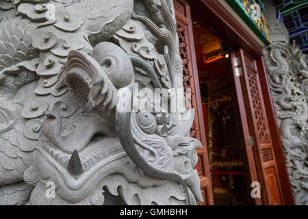 Close-up of a decorated stone column at the Po Lin Monastery on Lantau Island in Hong Kong, China. - Stock Photo