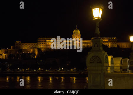 Buda Castle seen from the Széchenyi Chain Bridge, Budapest, at night - Stock Photo