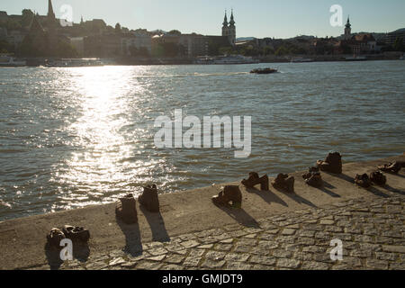 Iron shoe memorial on the bank of the Danube river, Budapest. - Stock Photo