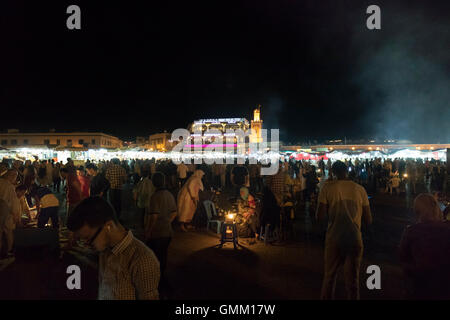 Djemaa el fna market in Marrakech, Morocco at night - Stock Photo