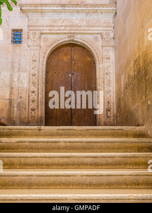 Italian Renaissance courtyard doorway and stairs inside Castle La Calahorra in La Calahorra Spain. - Stock Photo