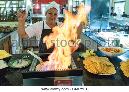 Flaming food crepes in Cuban resort. Beach resorts in the Caribbean Island are the main destination of international - Stock Photo