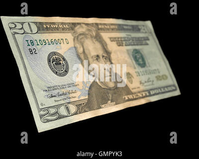 Isolated 20 Dollar bill on a black background - Stock Photo