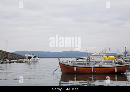 Boats moored at the port on a cloudy day - Stock Photo