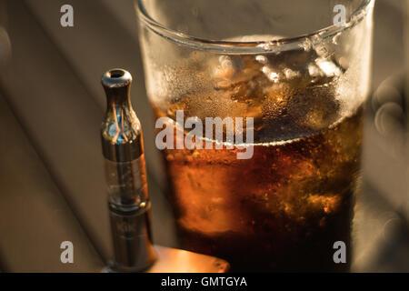vape and coke - Stock Photo