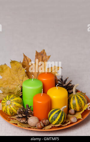 Fall holidays - Halloween and Thanksgiving. Still life - candles and pumpkins, pine cones, nuts, leaves. - Stock Photo