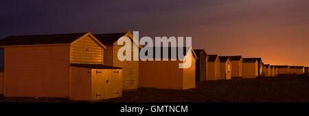 Time exposure of beach huts at Widewater - Stock Photo