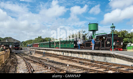 Isle of Wight Steam Railway tank engine No. 24 heads a train in Havenstreet Station on the Isle of Wight England - Stock Photo
