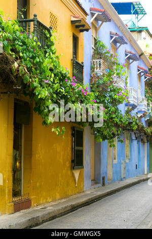 Colorful colonial architecture covered if lush beautiful flowers in Cartagena, Colombia - Stock Photo