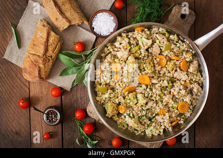 Tasty pearl barley porridge with vegetables and chicken. Top view - Stock Photo