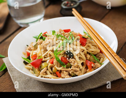 Udon noodles with meat and vegetables in an Asian style - Stock Photo