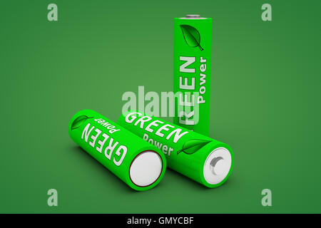 Three Green Eco Batteries on Green - Stock Photo