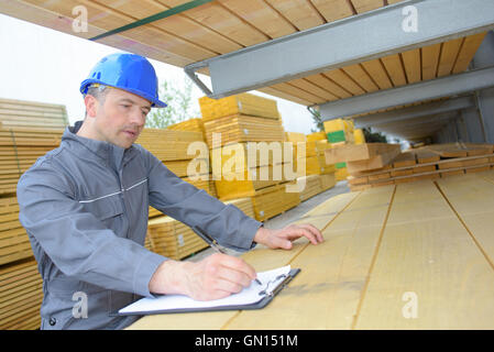 man in the warehouse - Stock Photo
