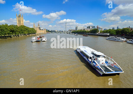 London England, UK. River Thames seen from Lambeth Bridge. Houses of Parliament (left) and MBNA Thames Clipper commuter - Stock Photo