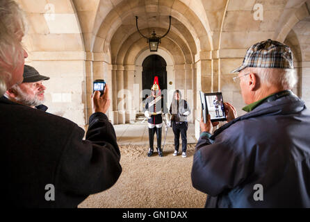 Tourists taking photos of Household Calvary at Horse Guards Parade in Westminster, London, UK. - Stock Photo