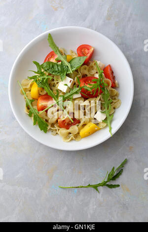 Pasta with cherry tomatoes and feta, food top view - Stock Photo