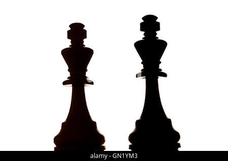 two chess kings in silhouette - Stock Photo
