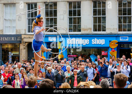 On the final weekend of the Edinburgh Fringe and Festival, the street performers entertain the visitors, tourists - Stock Photo