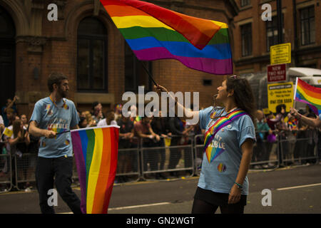 Manchester, UK. 27th August, 2016. Manchester Pride Parade. manchester pride big weekend, woman waves gay pride - Stock Photo