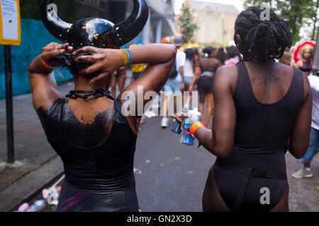 Two women revelers at the 50th Notting Hill Carnival, London, 2016. Credit:  wayne Tippetts/Alamy Live News - Stock Photo
