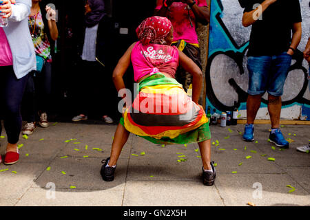 Dancing woman reveler at the 50th Notting Hill Carnival, London, 2016. Credit:  wayne Tippetts/Alamy Live News - Stock Photo