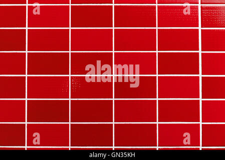 A red tiled background with relatively small tiles - Stock Photo
