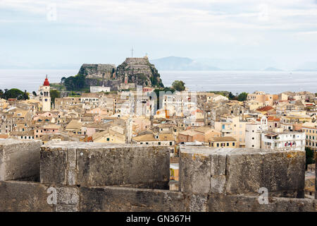 Aerial panorama of the old city of Corfu with the old fortress and the sea in the background. - Stock Photo