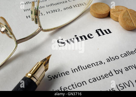 Page of hospital form with diagnosis swine flu and glasses. - Stock Photo