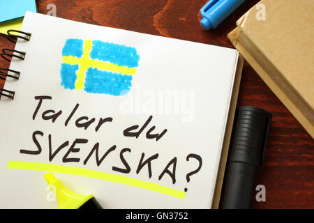 Learn swedish written in a notepad.  Education concept. - Stock Photo