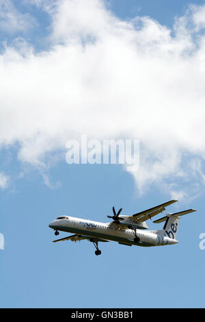 Flybe Bombardier Dash 8 approaching Birmingham Airport, UK (G-JECJ) - Stock Photo