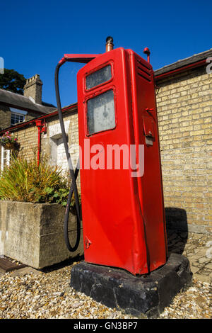 Old fashioned, vintage red petrol (gas) pump - Stock Photo